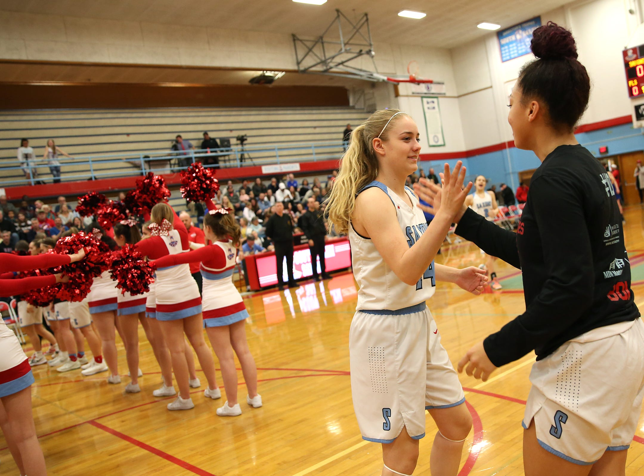 South Salem's Madelynn Hoffman (14) is introduced in the starting lineup before the South Salem High School girls basketball game against McNary High School in Salem on Thursday, Jan. 31, 2019.
