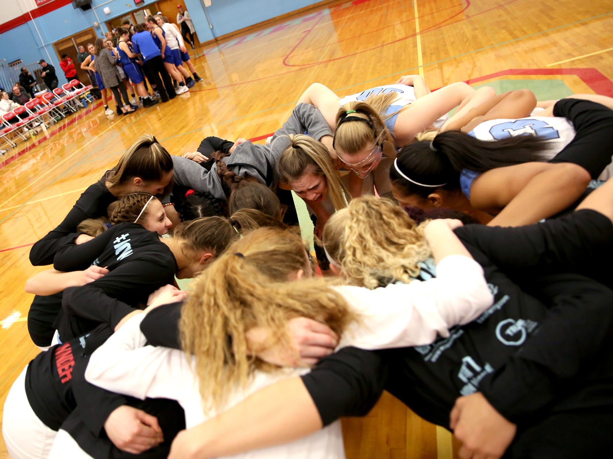 South Salem huddles before the South Salem High School girls basketball game against McNary High School in Salem on Thursday, Jan. 31, 2019.