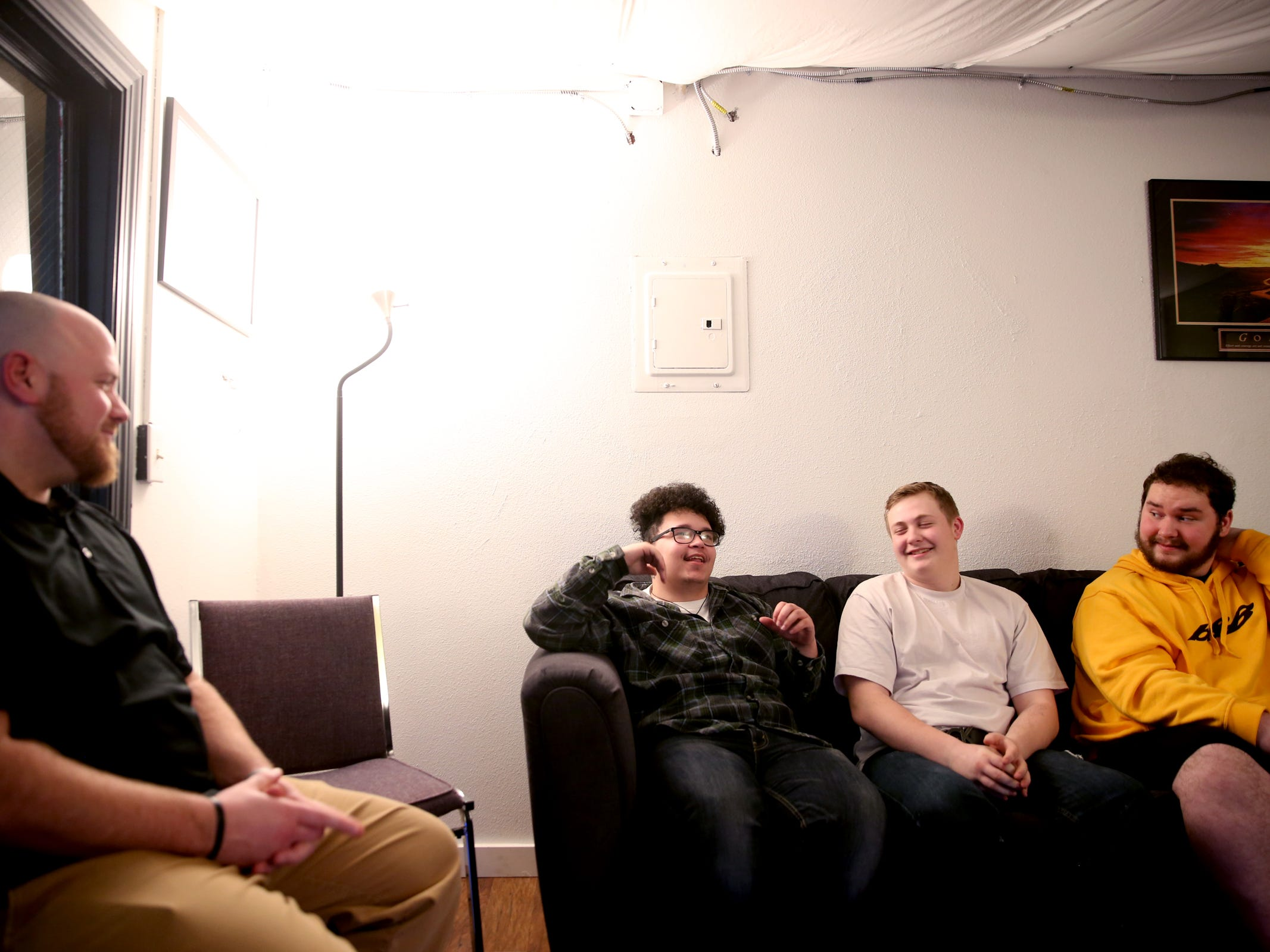 Sonny Saltalamachia, from left, the clinical supervisor of adolescent services with Bridgeway Recovery Services, talks with Caleb McDonald, 18, Andrew McMains, 17, and David Bond, 18, all of Salem, at IKE Box in Salem on Thursday, Jan. 31, 2019. Songs the teens wrote placed in the Teens Make Music national competition, organized by MusiCares, and they will travel to this year's GRAMMY Awards in Los Angeles.