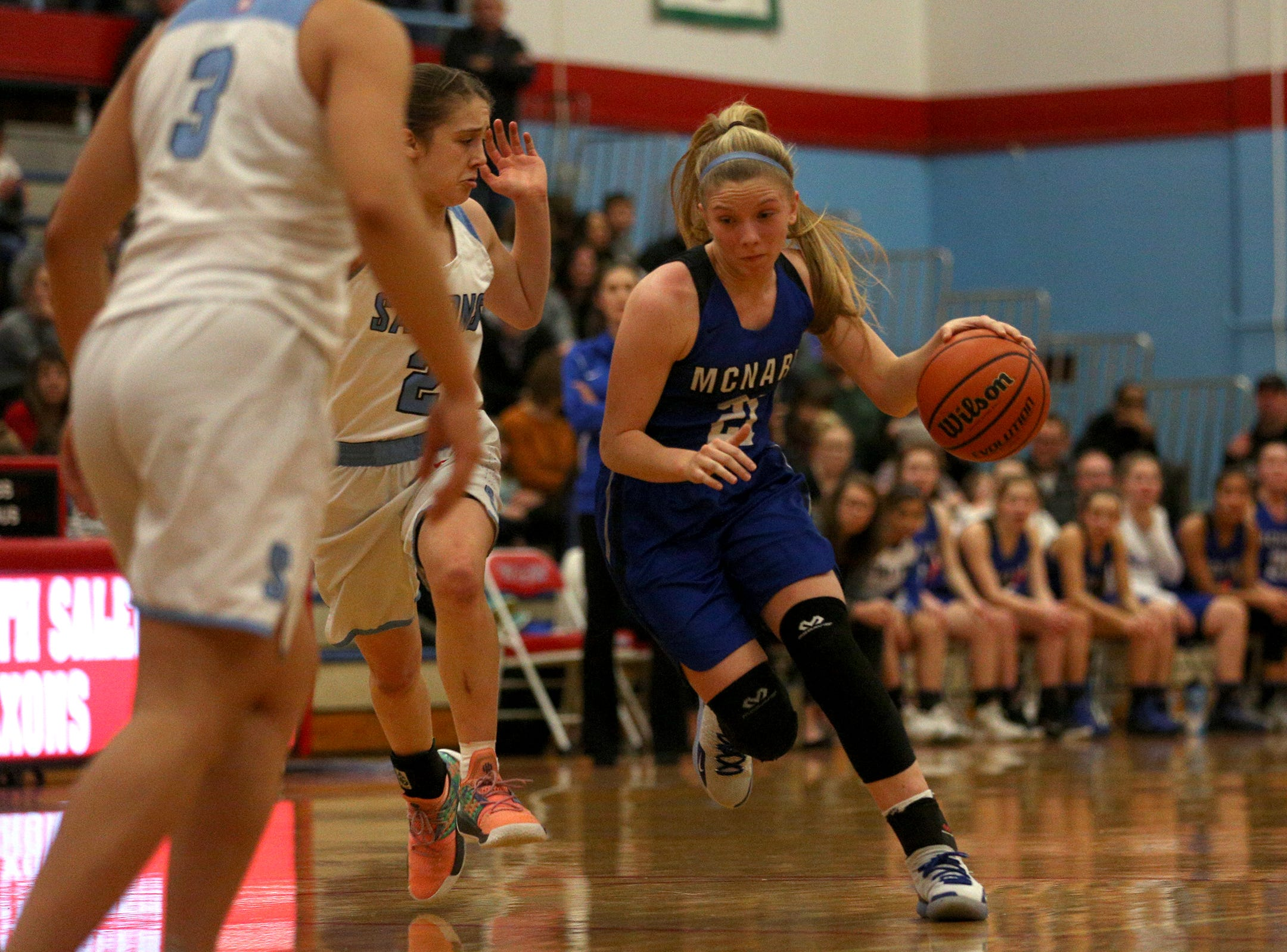 McNary's Abigail Hawley gets across South Salem's defense during the South Salem High School girls basketball game against McNary High School in Salem on Thursday, Jan. 31, 2019.