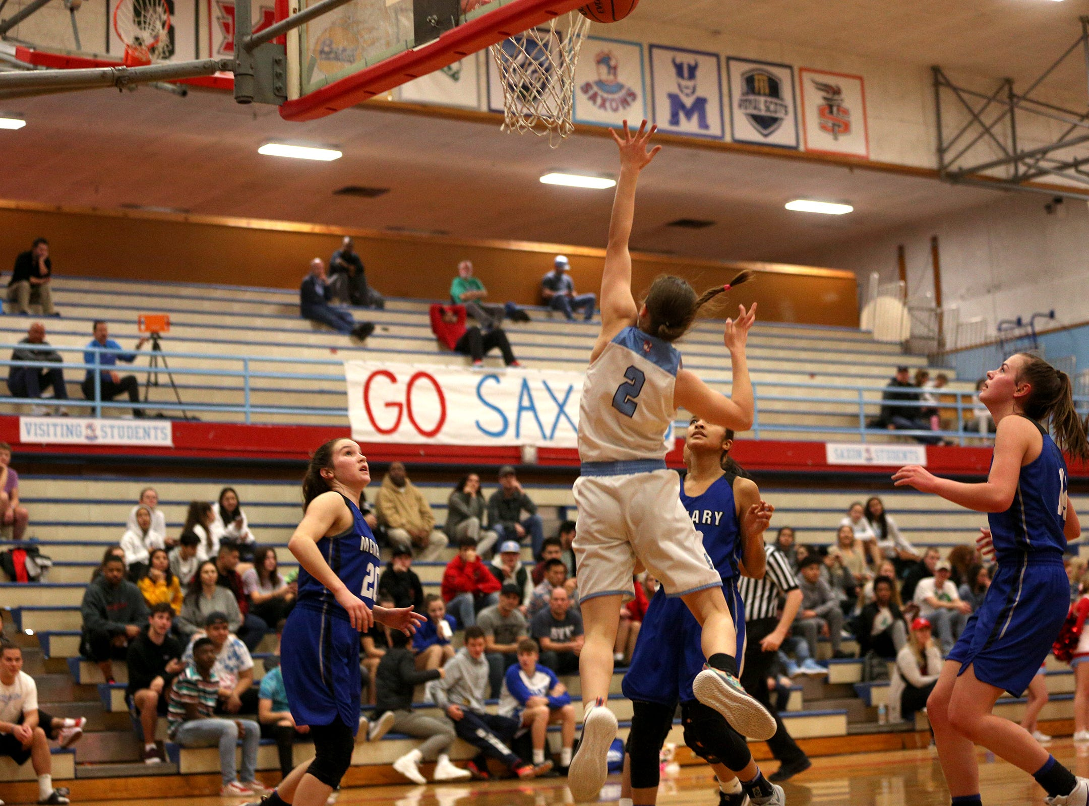 McNary's Hilary James (2) attempts to get the ball in during the South Salem High School girls basketball game against McNary High School in Salem on Thursday, Jan. 31, 2019.
