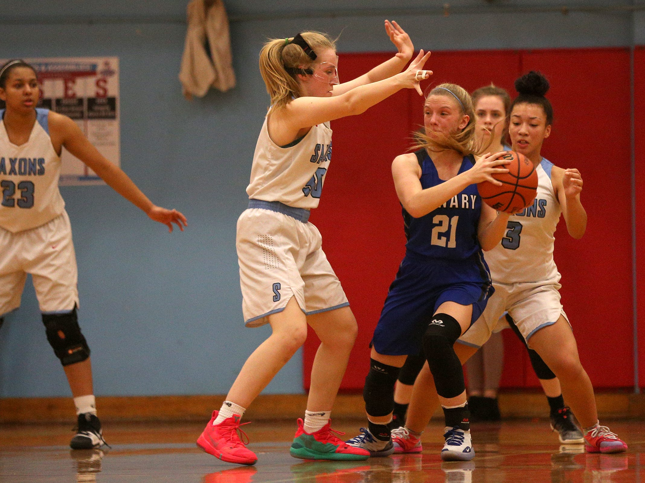 McNary's Abigail Hawley (21) looks to make her way around South Salem's defense during the South Salem High School girls basketball game against McNary High School in Salem on Thursday, Jan. 31, 2019.