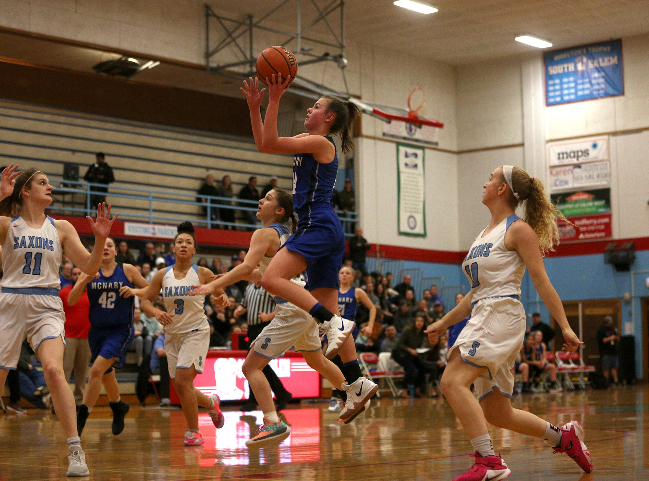 McNary's Leah Doutt (14) attempts a layup during the South Salem High School girls basketball game against McNary High School in Salem on Thursday, Jan. 31, 2019.