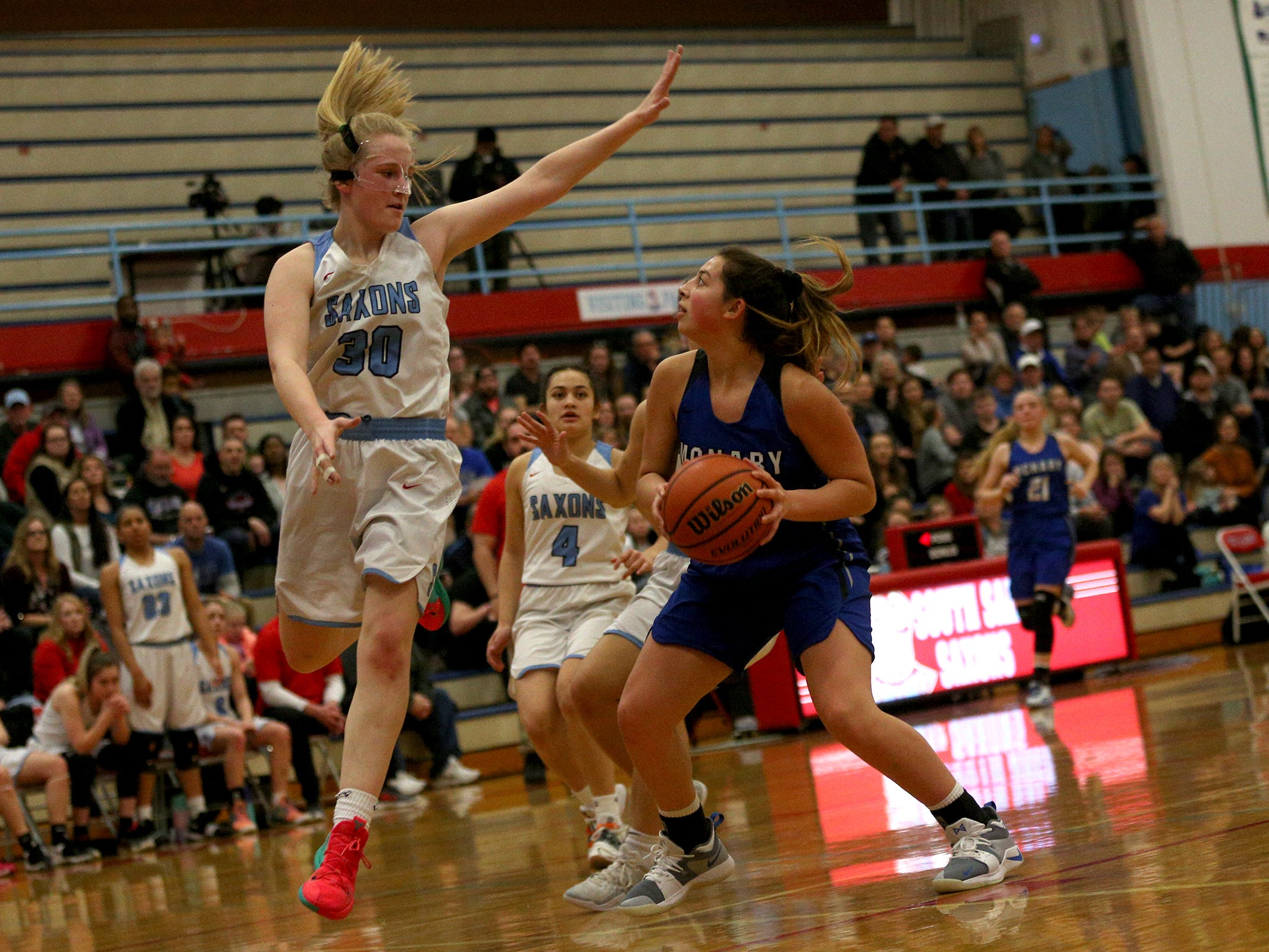 South Salem's Gretchen Olsen (30) blocks McNary's Mackenzie Proctor (33) during the South Salem High School girls basketball game against McNary High School in Salem on Thursday, Jan. 31, 2019.