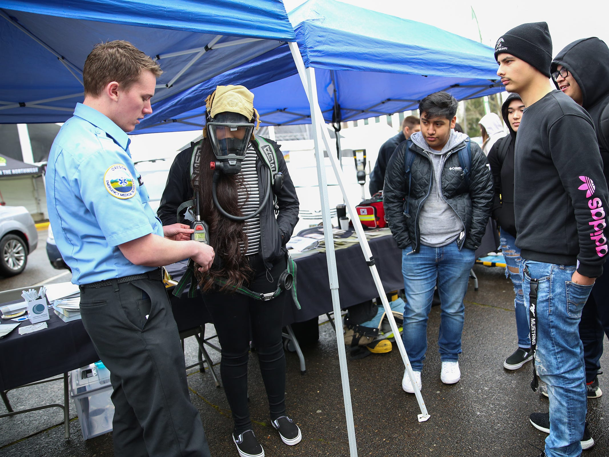 Riley Holmes , a paramedic student at Chemeketa community college (far left) demonstrates how to use a mask in an emergency during Career and Technical Education (CTE) day at the Oregon State Capitol in Salem on Friday, Feb. 1, 2019.