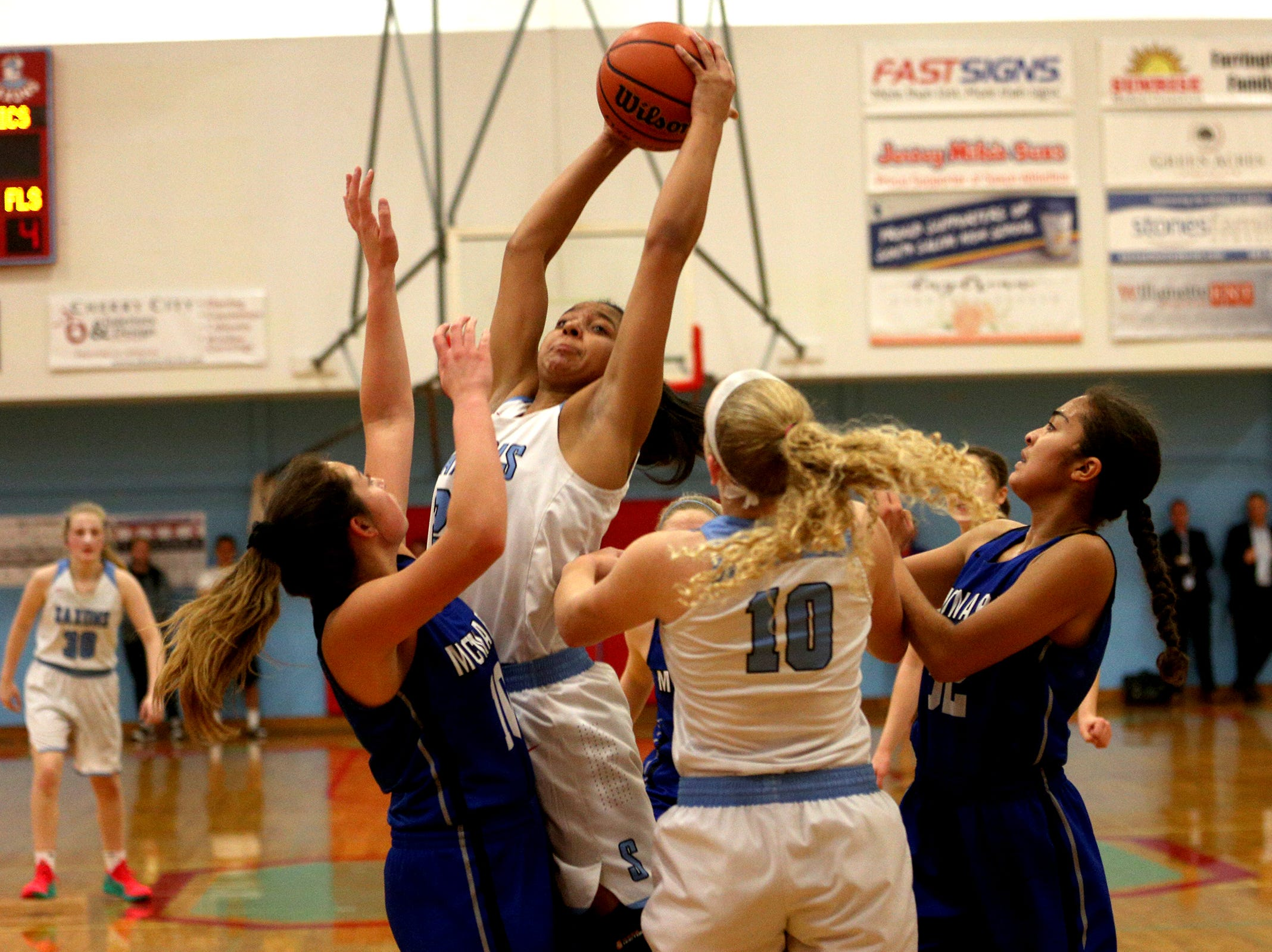 South Salem's Victoria Stafford (23) rebounds during the South Salem High School girls basketball game against McNary High School in Salem on Thursday, Jan. 31, 2019.