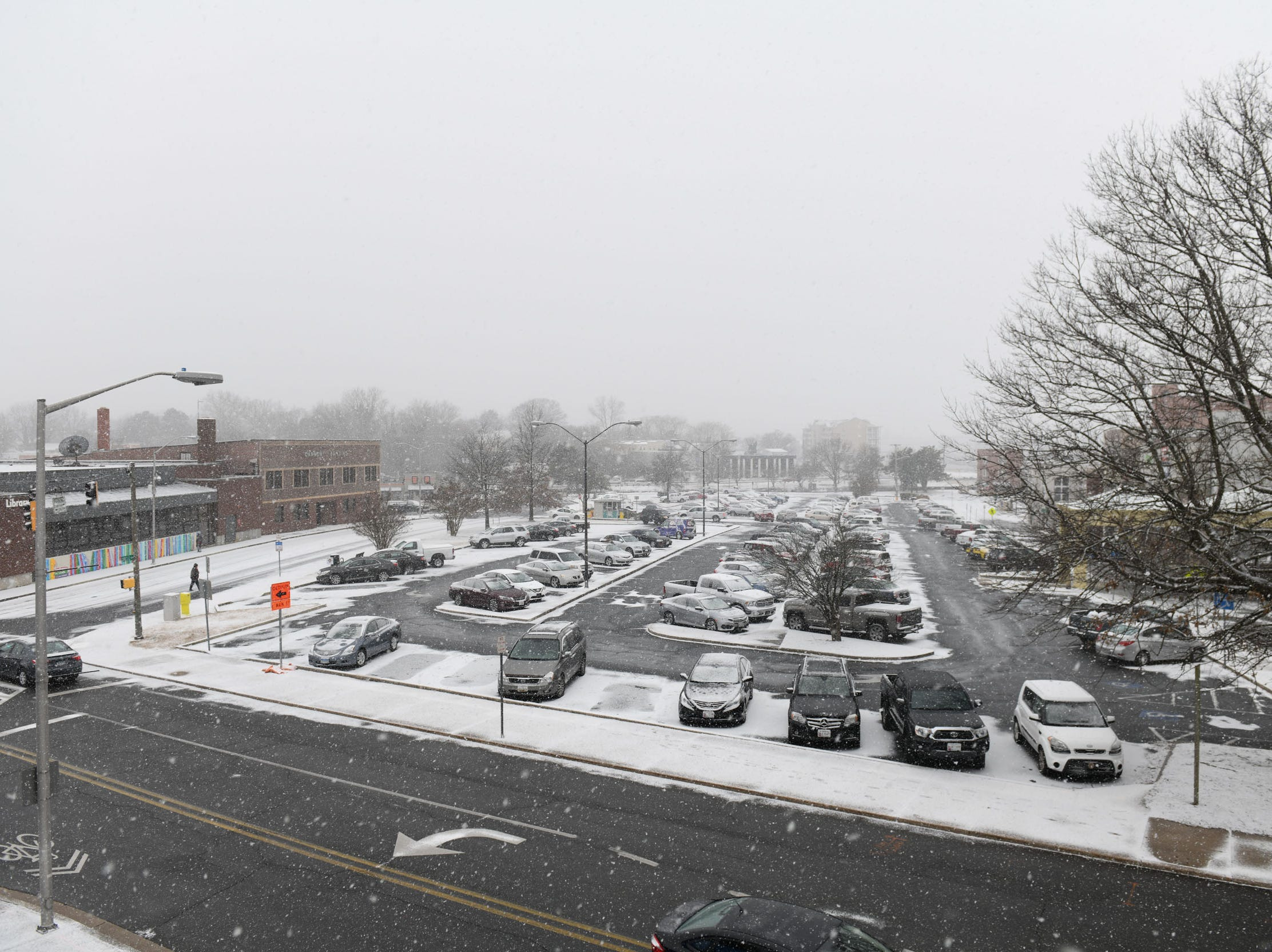 A snowy view of Downtown Salisbury from the top of the parking garage as snow continues to fall on Friday, Feb. 1, 2019.