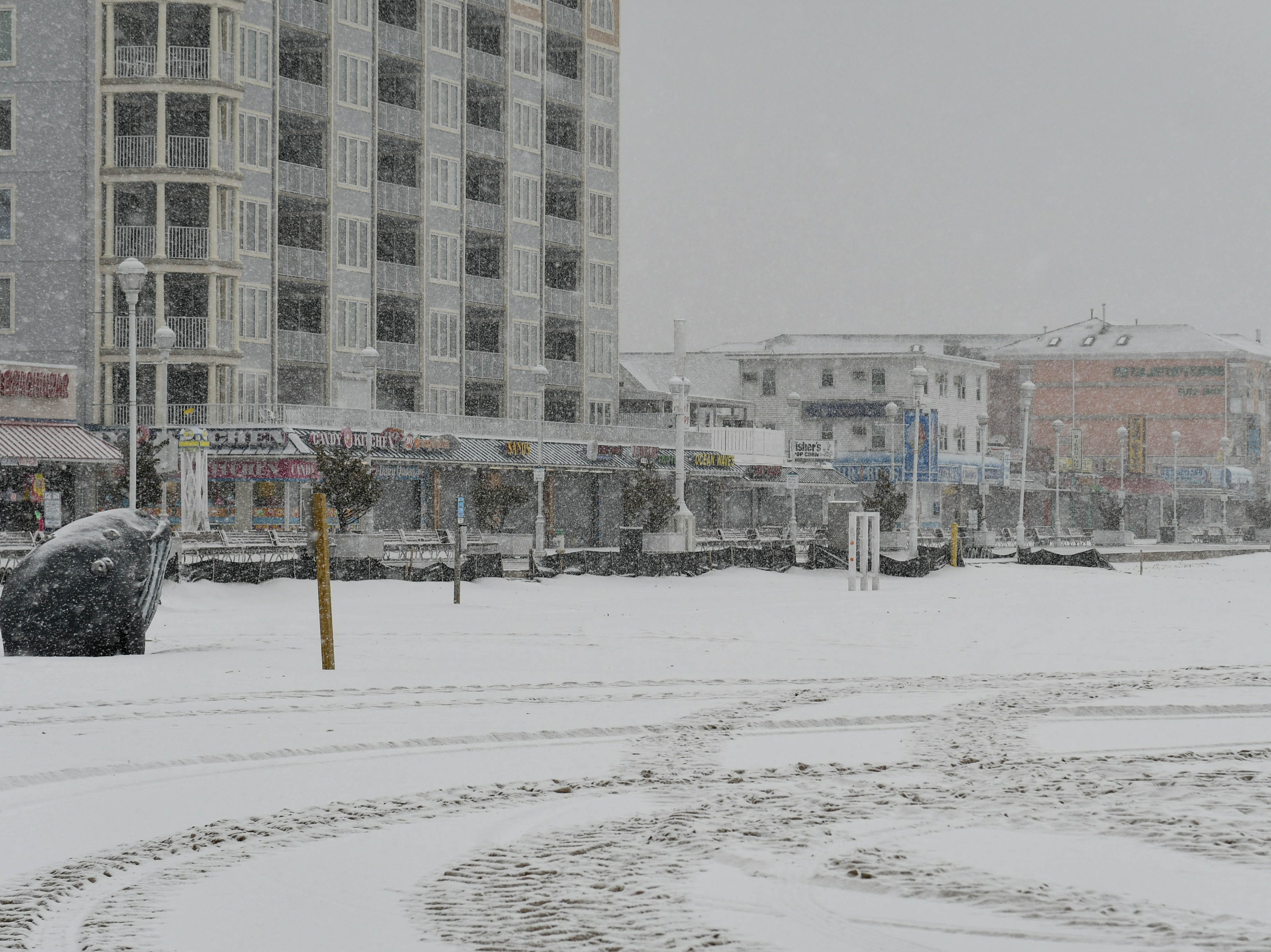 Snow coats the Ocean City boardwalk during a storm on Friday, Feb. 1, 2019.
