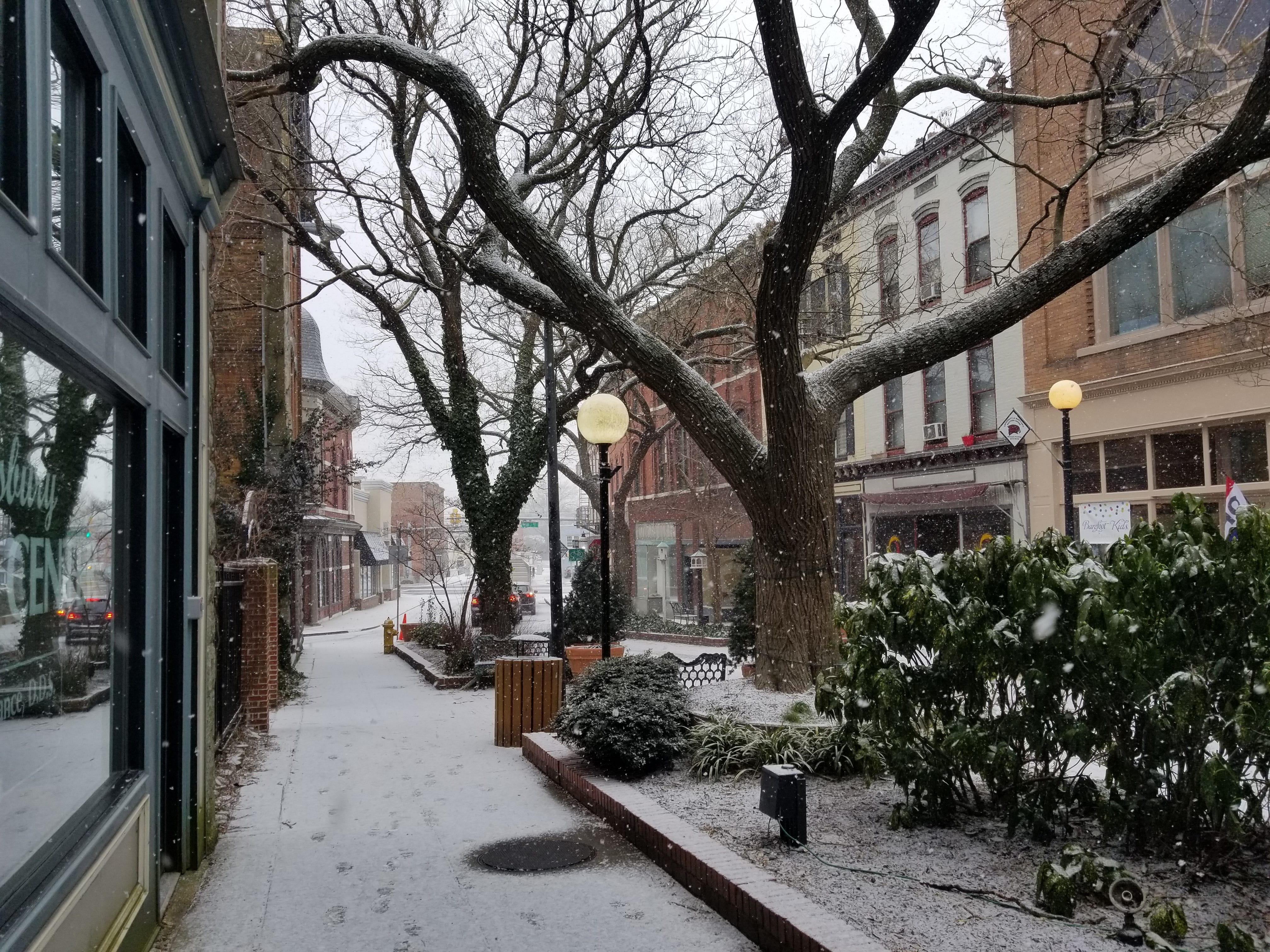 Snow falls Friday on the Downtown Plaza in Salisbury.