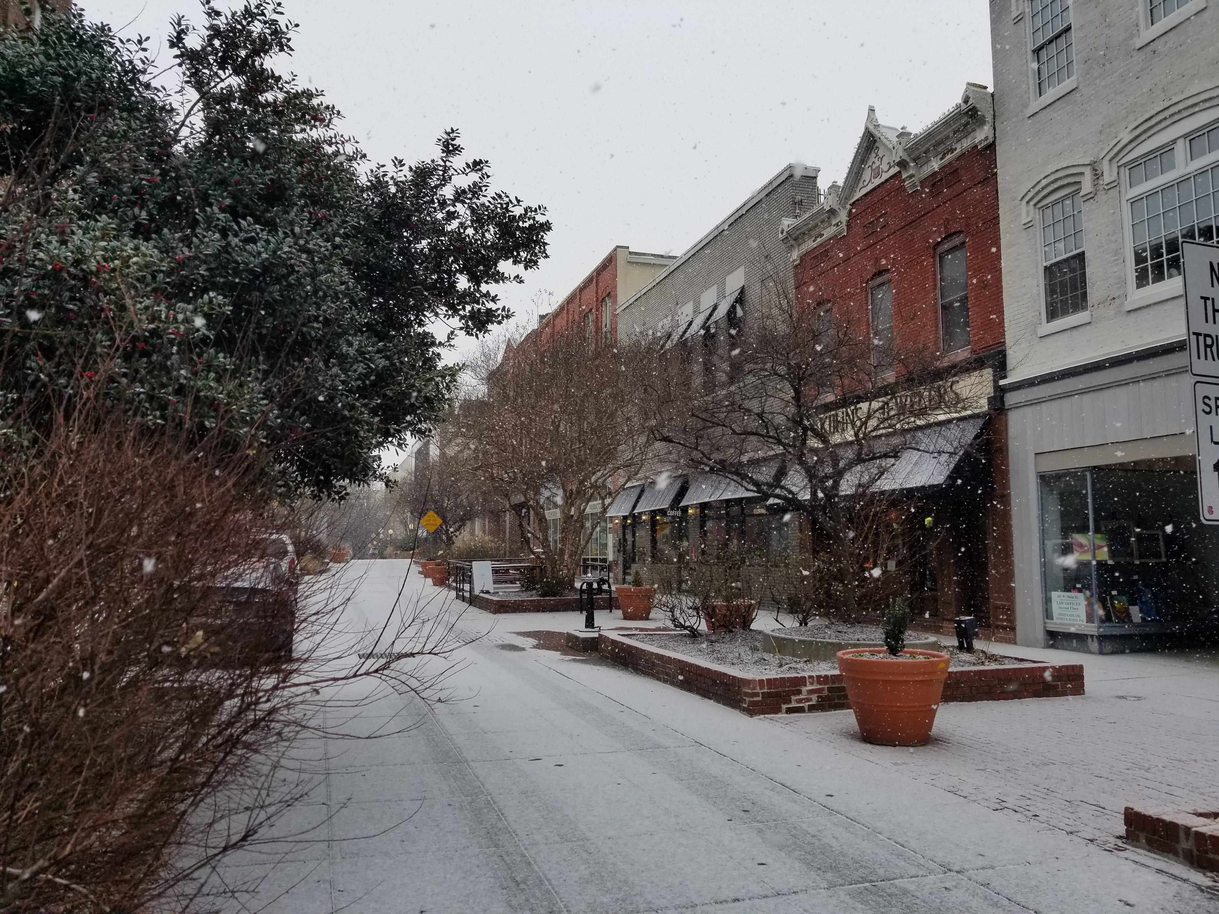 Snow falls Friday in downtown Salisbury.