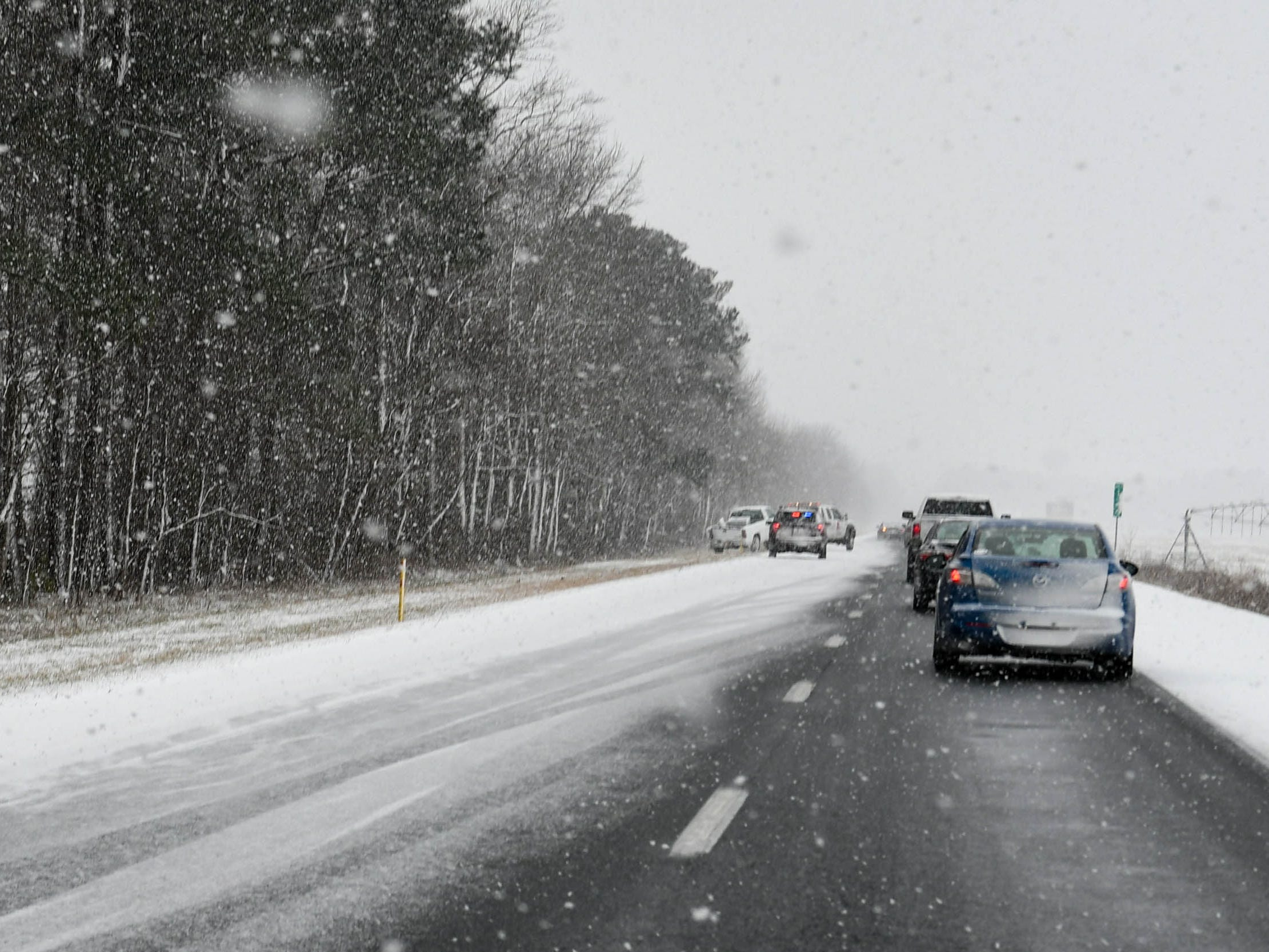 Traffic backs up on Route 50 after cars slide off during a storm on Friday, Feb. 1, 2019.