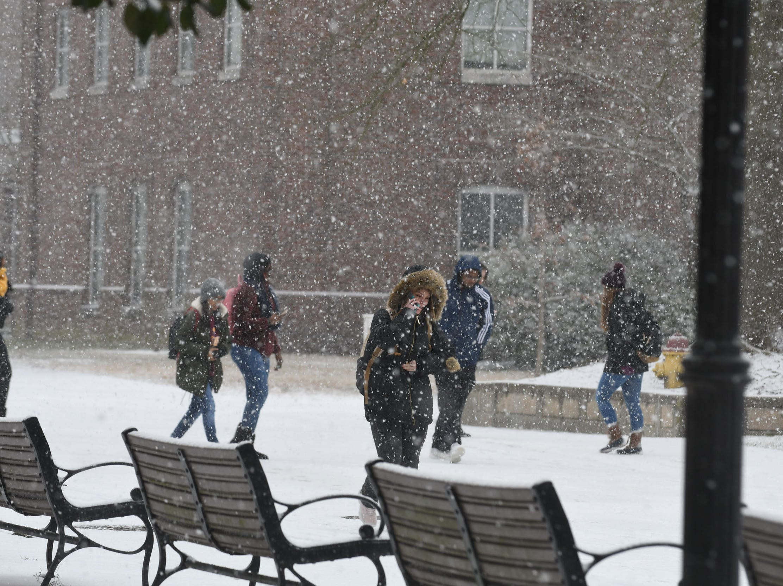 Salisbury University students walk inbetween classes on Friday, Feb 1, 2019 as snow falls on the Eastern Shore.