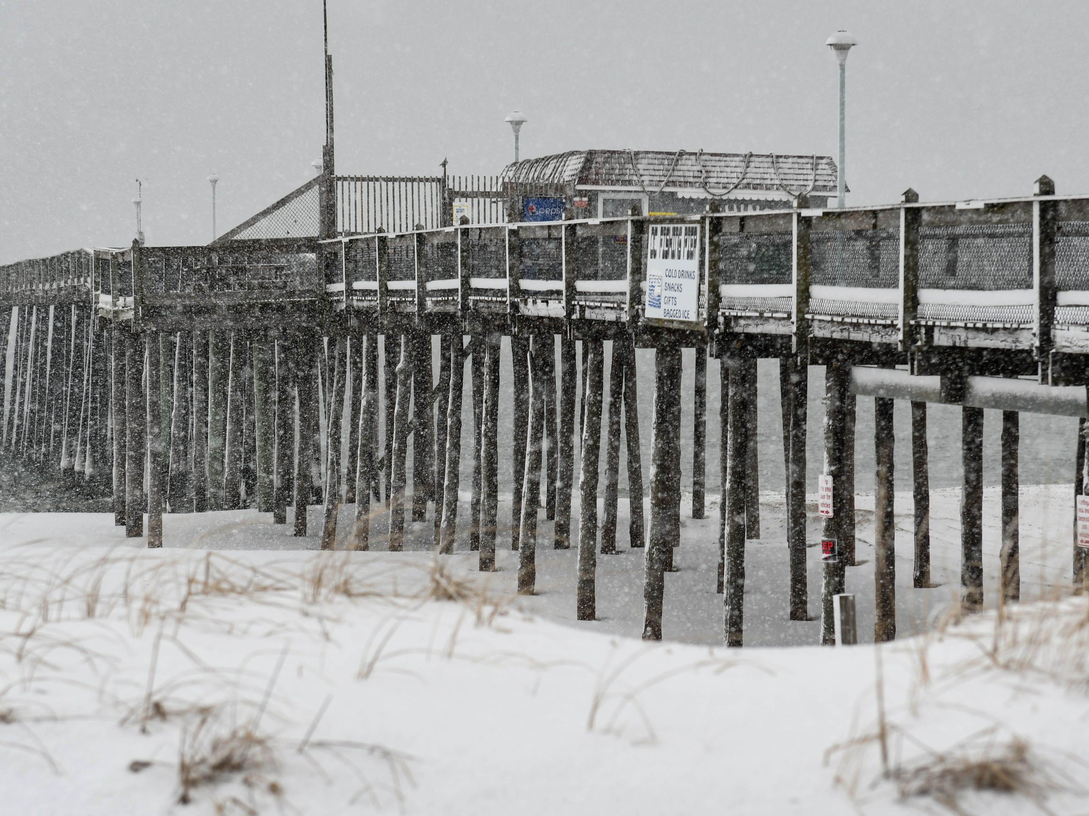 Snow coats the Ocean City beach during a storm on Friday, Feb. 1, 2019.