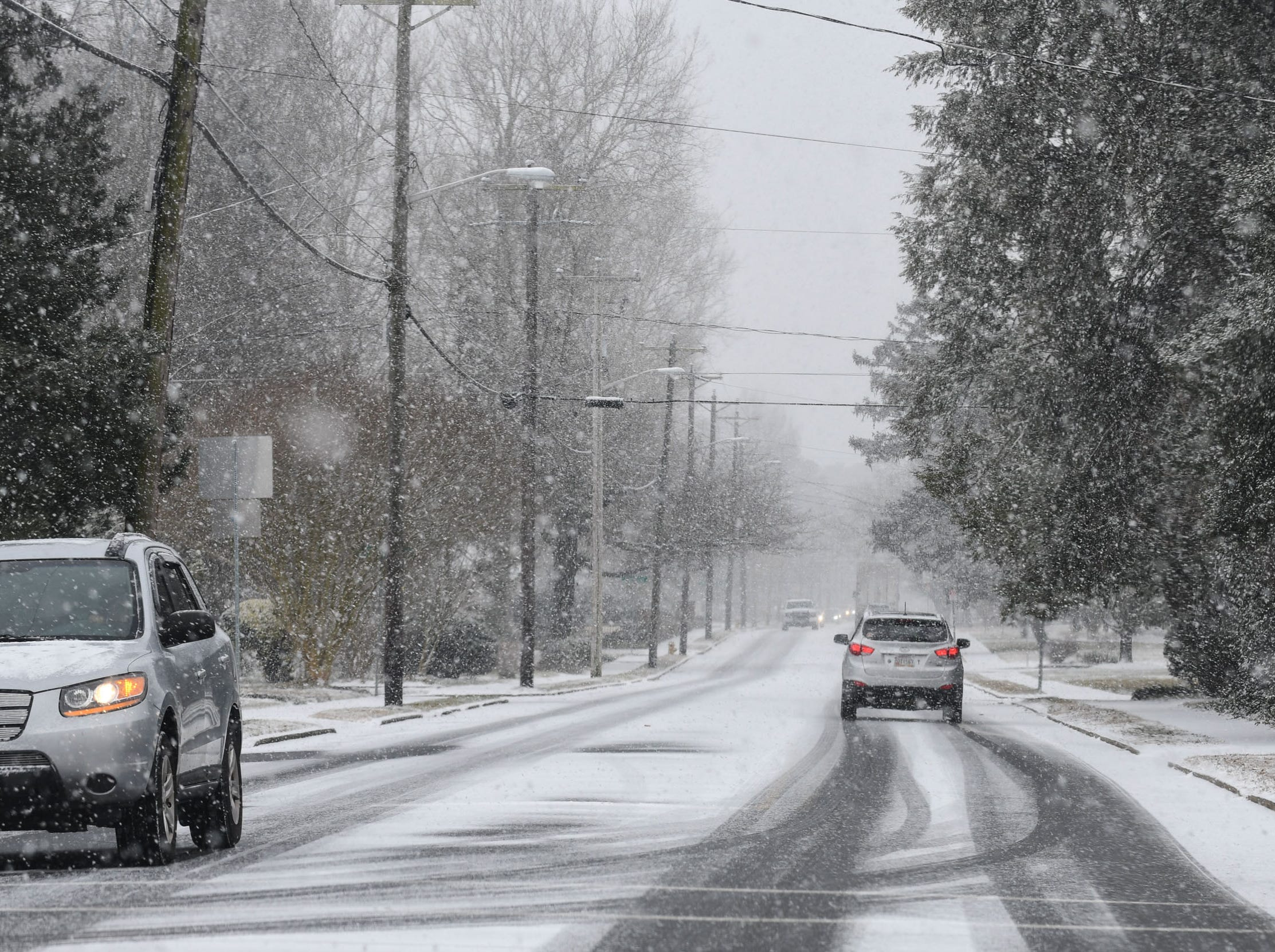 Snow falling is starting to accumulate on Camden ave. in Salisbury on Friday, Feb. 1, 2019.