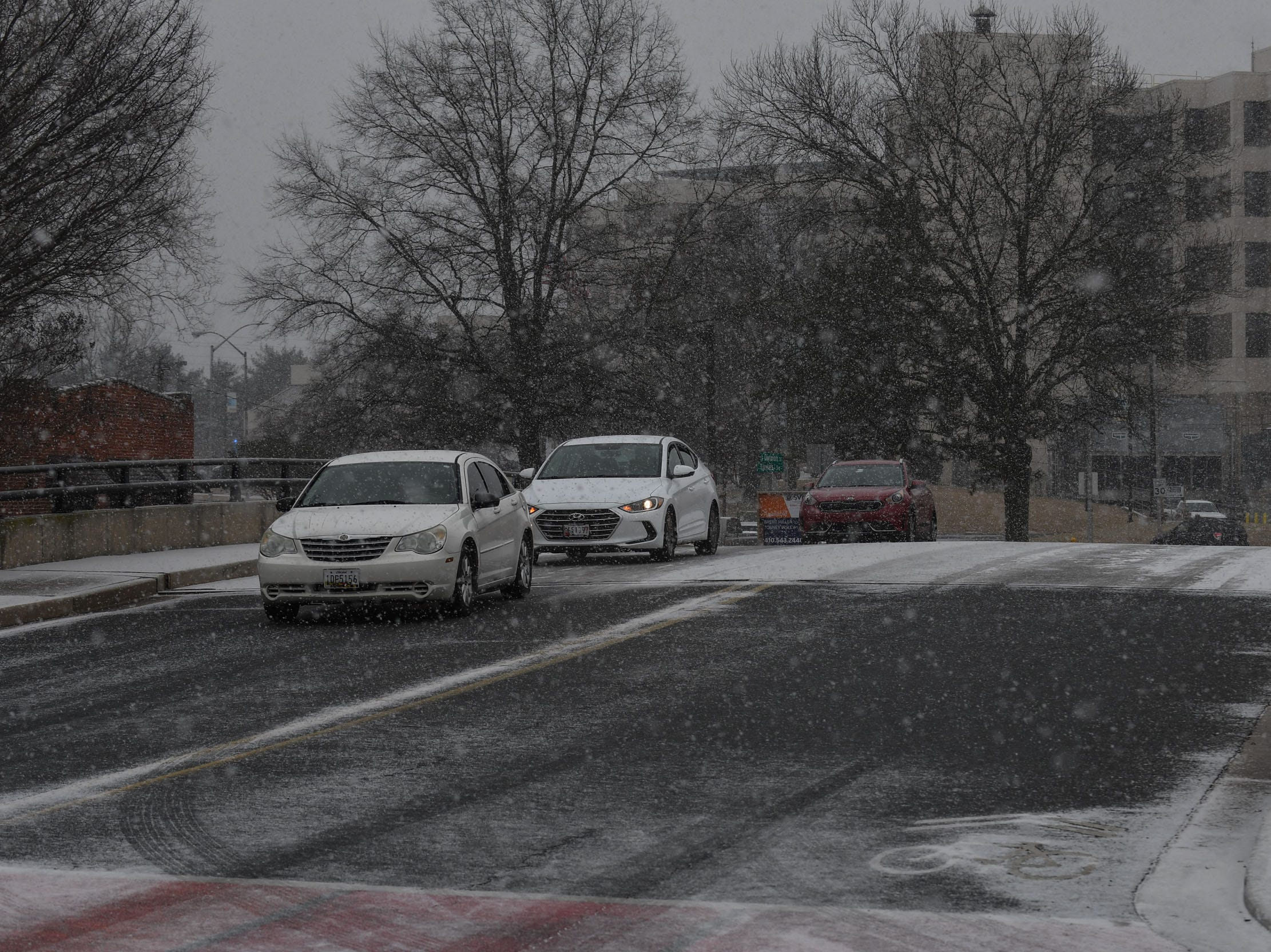 Snow starts to stick to the roads on Friday, Feb 1, 2019 as a snow front moves through Delmarva.