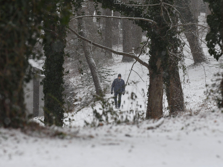 A man walks through the snow at the Salisbury City Park on Friday, Feb. 1, 2019.