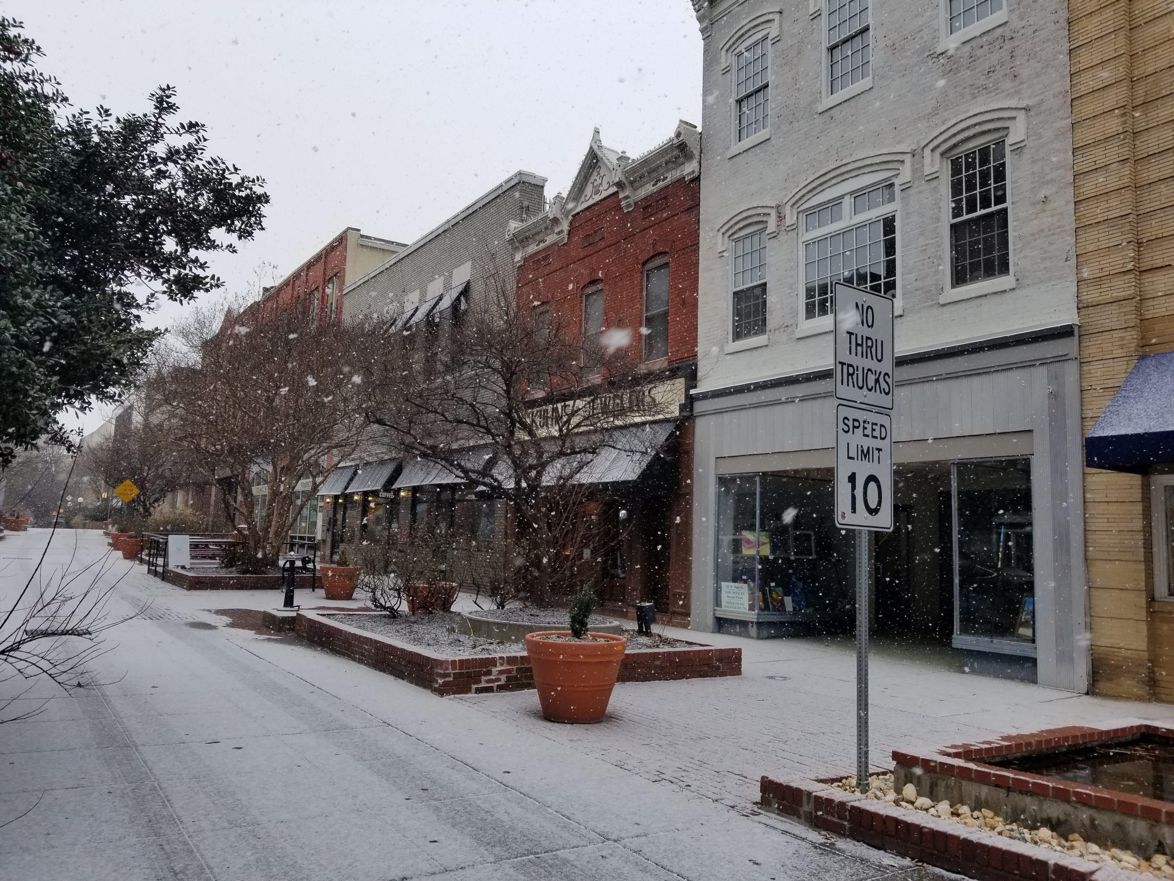 Snow falls on Salisbury's Downtown Plaza on Friday.