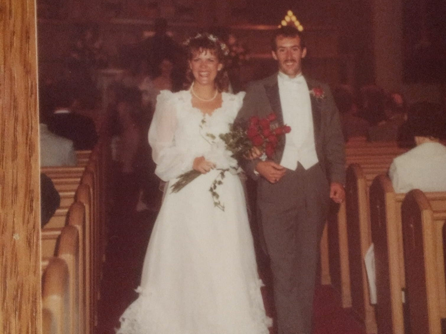 "Angie and Mark Dahm on their wedding day in 1984 at  Zion UCC in Sheboygan.  ""Mark and I met at a party, right when I moved from Minneapolis to Colorado. He grew up in Minneapolis, so we had a lot in common. My friends couldn't believe I had to move to Colorado to meet a guy from Minnesota!"" said Angie."