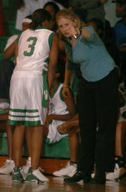 Former Bossier High girls' basketball coach Mary Ward talks to Tierra Darby during the team's 2003 victory over Haughton in this file photo. Ward recently surpassed 300 victories.