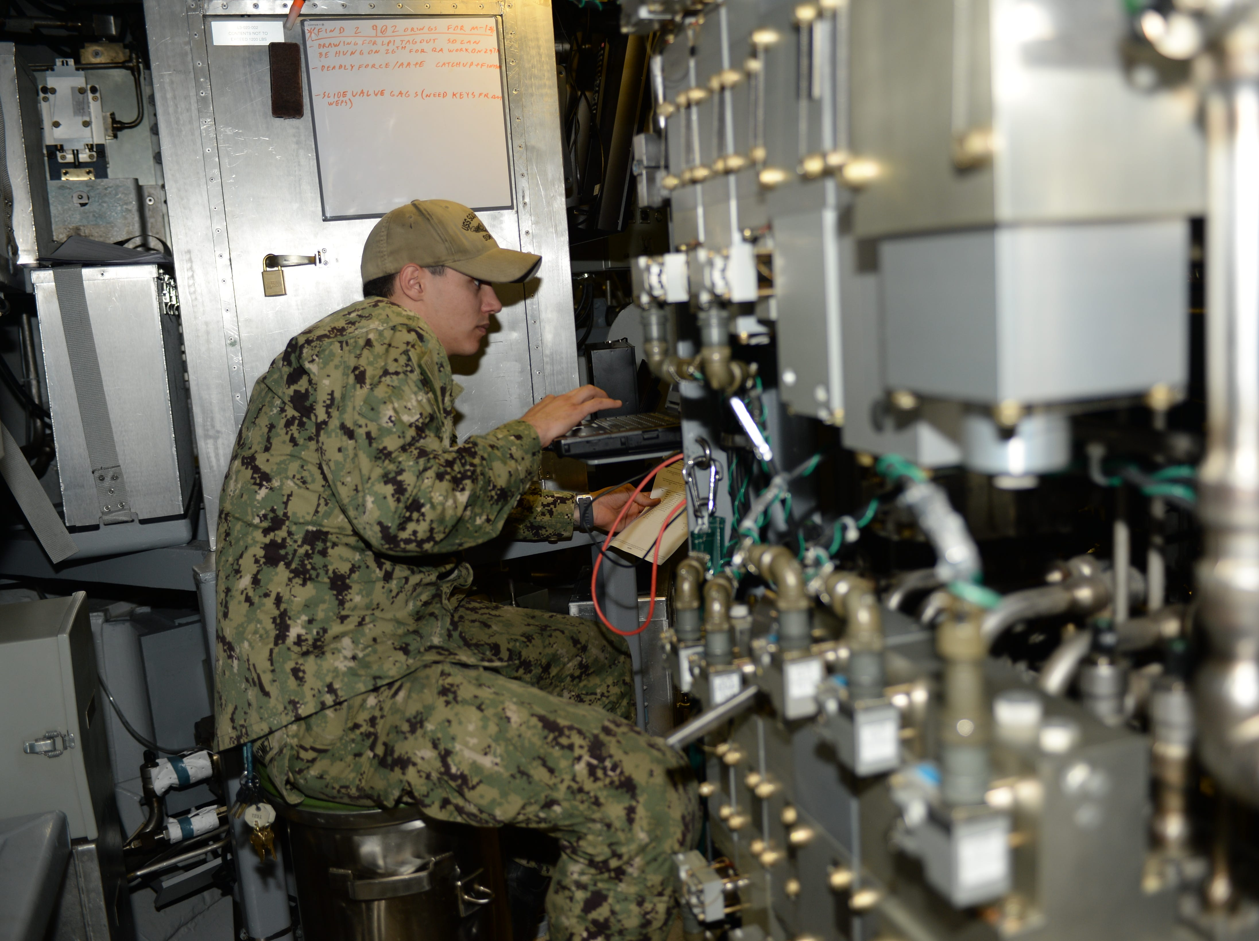 Machinist's Mate (Submarine Weapons) 2nd Class Colton Gomez works in the torpedo room aboard Pre-commissioning Unit South Dakota (SSN 790). South Dakota is the 17th Virginia-class, fast-attack submarine and is scheduled to be commissioned Feb. 2, 2019.