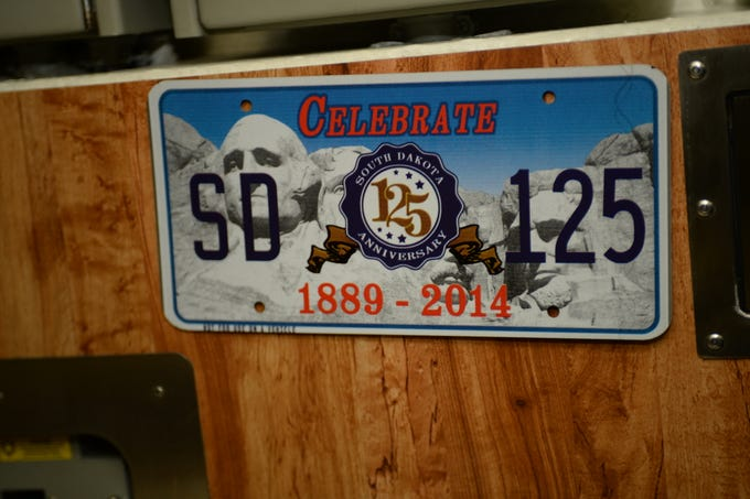 A photo of South Dakota license plate memorabilia in the crew's dining area aboard Pre-commissioning Unit South Dakota (SSN 790). South Dakota is the 17th Virginia-class, fast-attack submarine and is scheduled to be commissioned Feb. 2, 2019. (U.S. Navy photo by Chief Mass Communication Specialist Monique Meeks/Released)