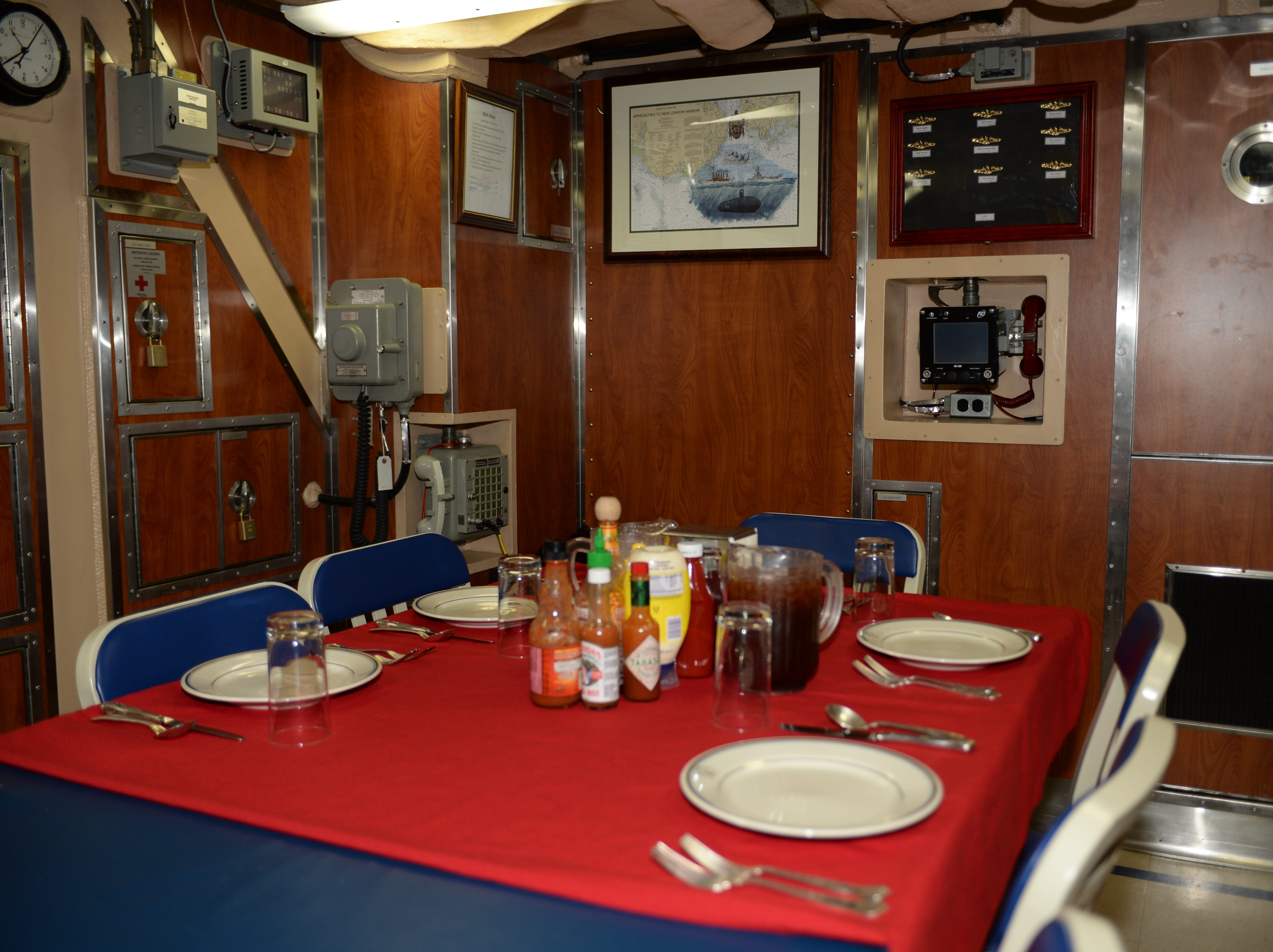 A photo of the wardroom dining space aboard Pre-commissioning Unit South Dakota (SSN 790). South Dakota is the 17th Virginia-class, fast-attack submarine and is scheduled to be commissioned Feb. 2, 2019.