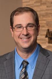 Joseph Medema, retail branch manager at American Bank & Trust's River Centre location in Sioux Falls