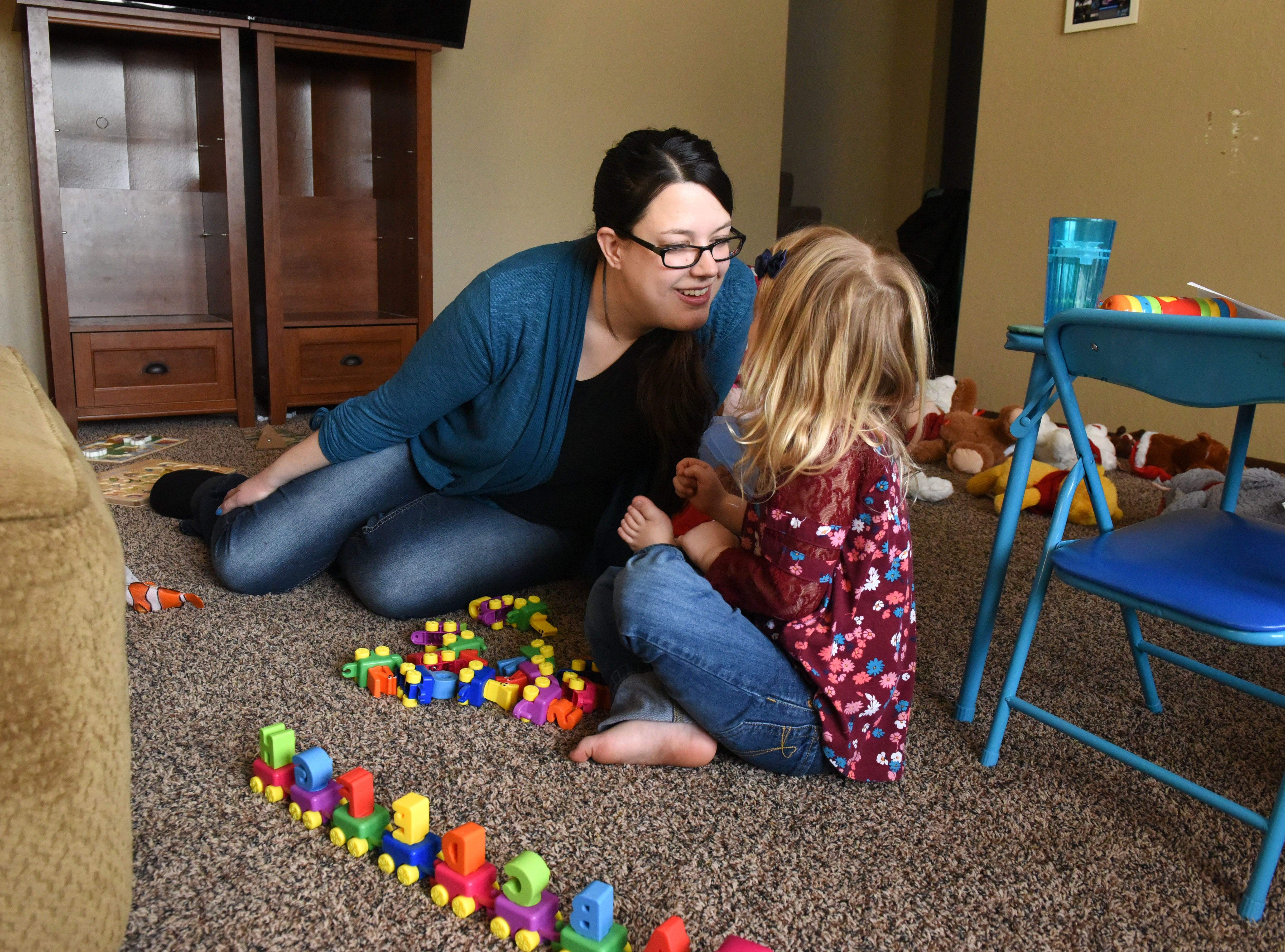 Krystal Trull plays with her daughter Nikole Trull, 4, at their house in Sioux Falls, S.D., Friday, Feb. 1, 2019.