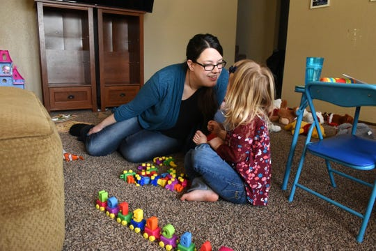 Krystal Trull plays with her daughter Nikole Trull, 4, at their house in Sioux Falls in February. The family lost autism treatment coverage for Nikole in December and spent months going without care.