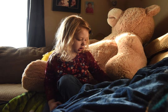 Nikole Trull, 4, sits on the couch in her living room in Sioux Falls, S.D., Friday, Feb. 1, 2019.