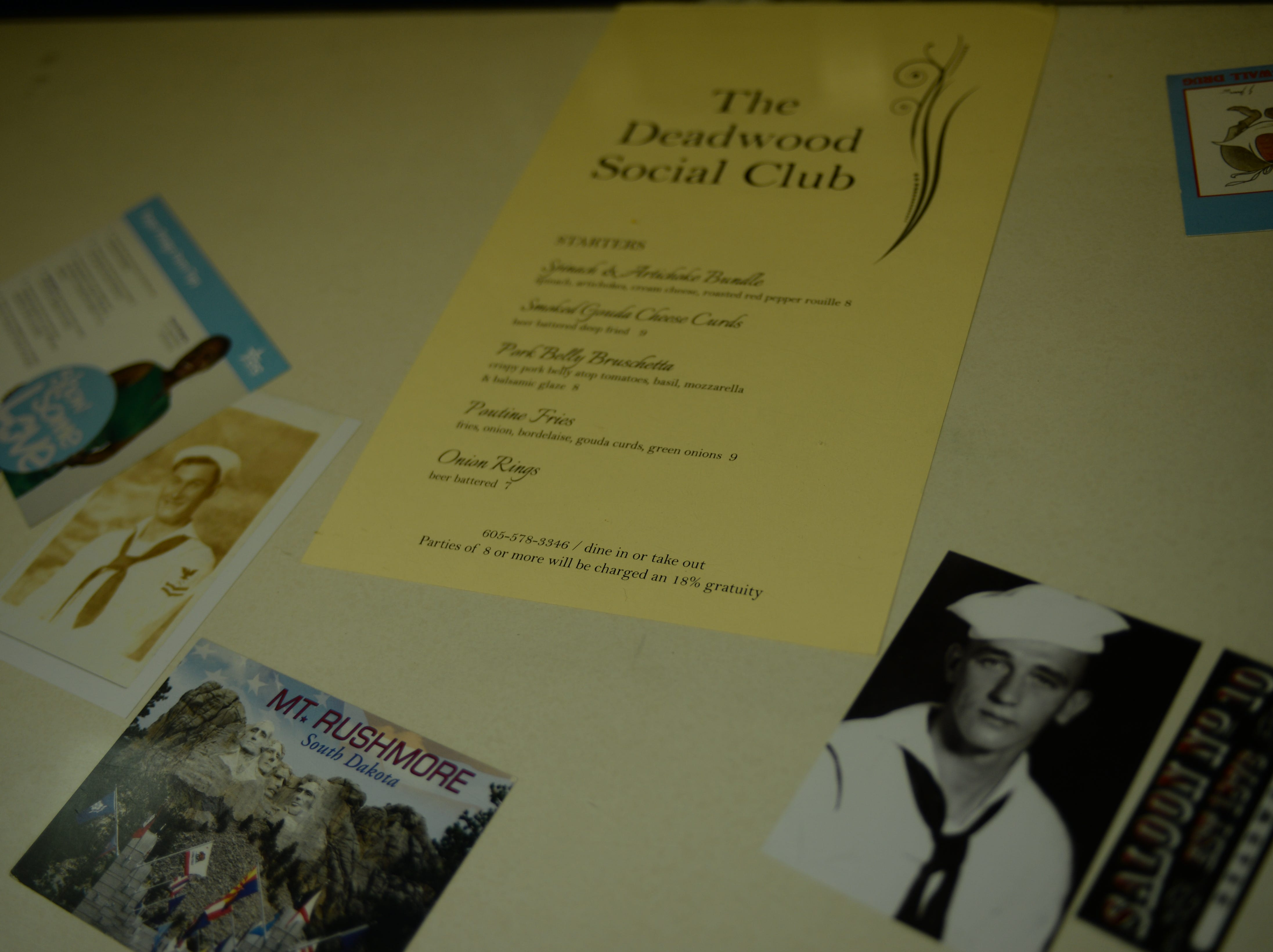 A photo of the pictures embedded on the crew mess dining tables aboard Pre-commissioning Unit South Dakota (SSN 790). South Dakota is the 17th Virginia-class, fast-attack submarine and is scheduled to be commissioned Feb. 2, 2019.