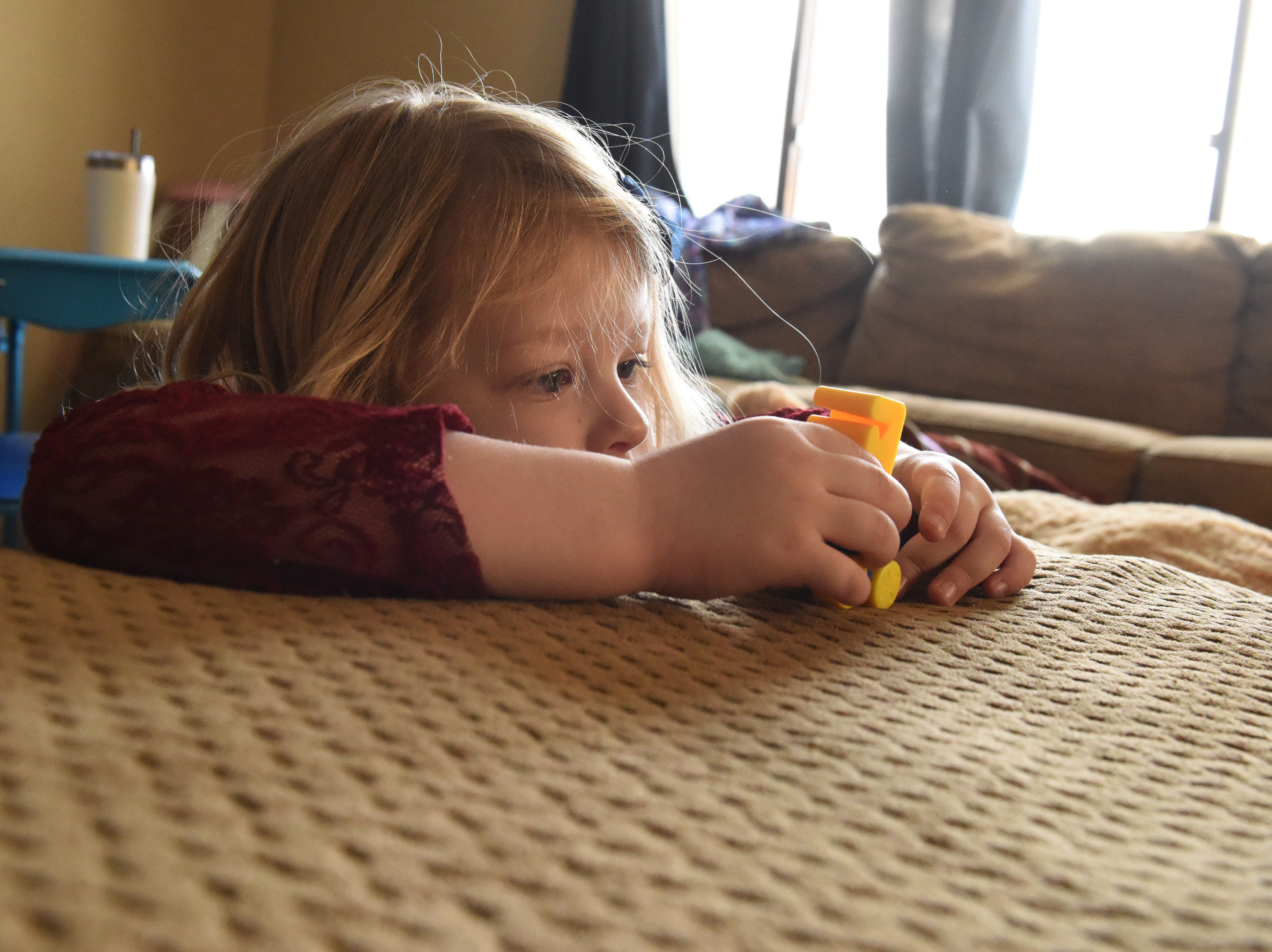 Nikole Trull, 4, plays around her living room in Sioux Falls, S.D., Friday, Feb. 1, 2019.