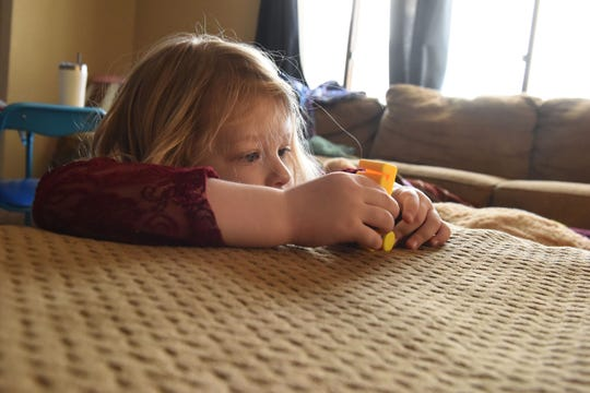 Nikole Trull, 4, plays around her living room in Sioux Falls, S.D., Friday, Feb. 1, 2019. The Trull family lost coverage of Nikole's ABA therapy this year due to a loophole for small-group and individual plans.