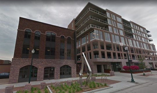The old Johnson's Furniture building (left) is shown next to Washington Square in downtown Sioux Falls.
