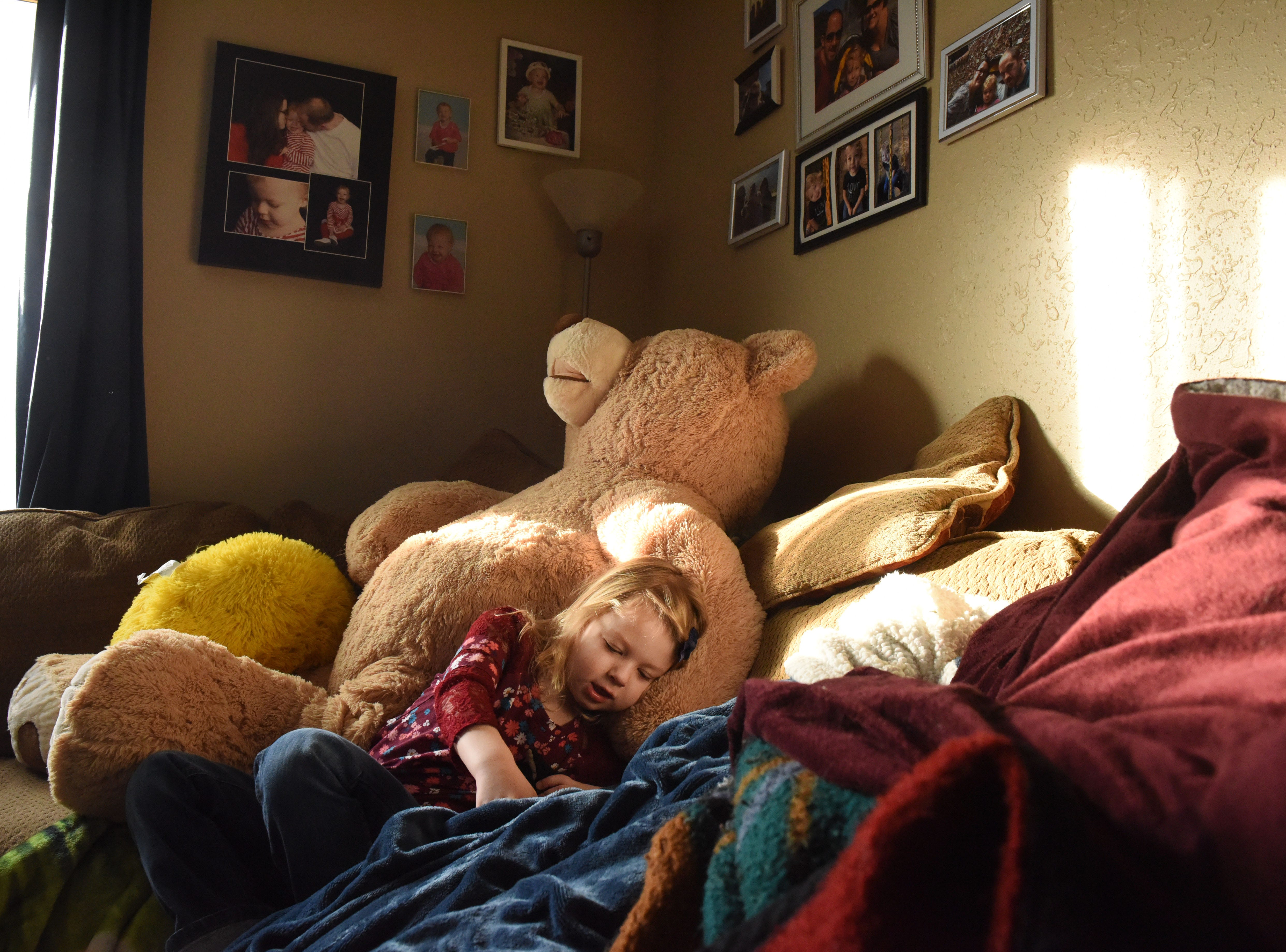 Nikole Trull, 4, rests on the couch in her living room in Sioux Falls, S.D., Friday, Feb. 1, 2019.