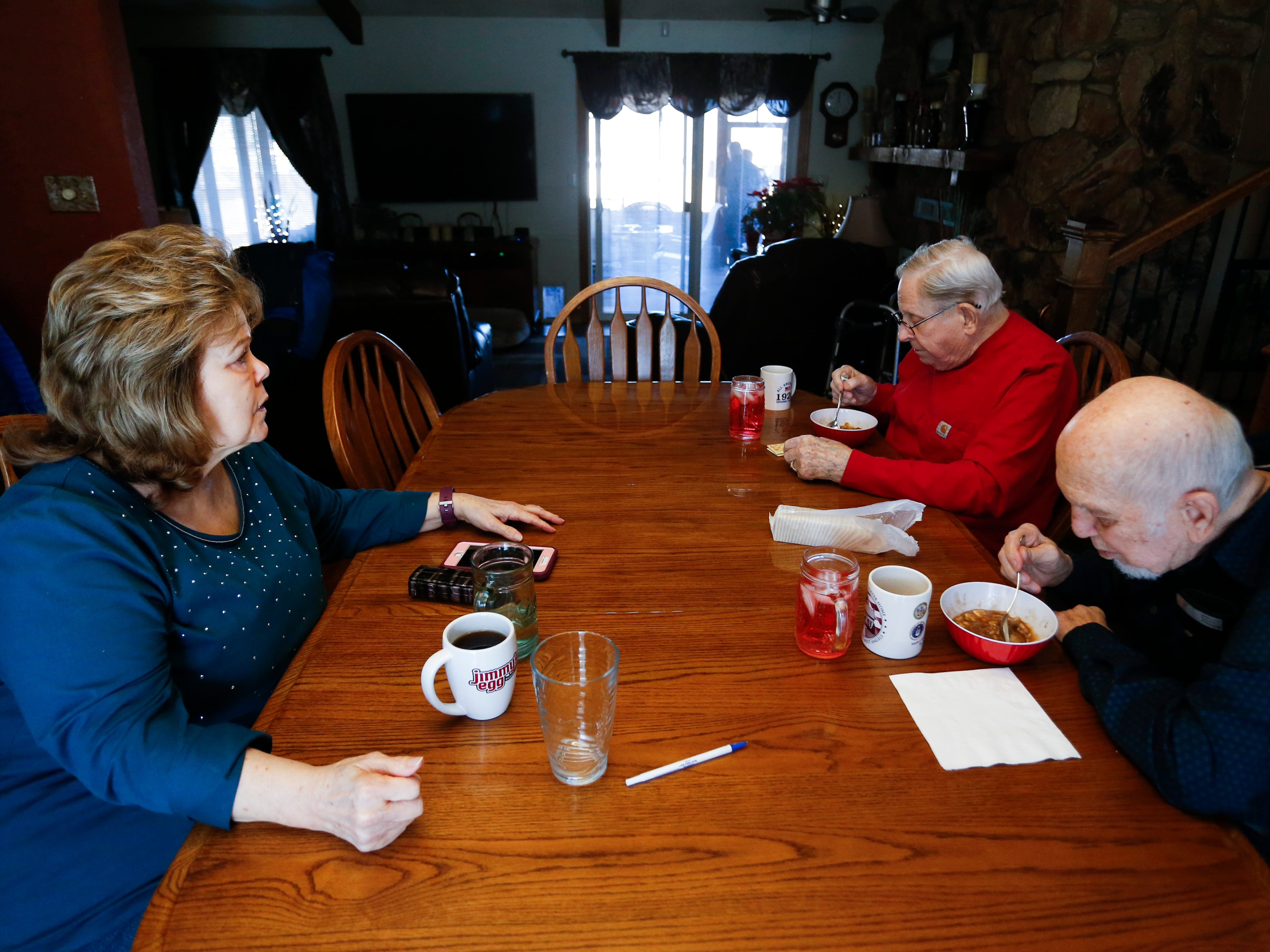 Joyce Keim talks with veterans Donald Gundlach (center), 92, and Gene Solomon, 77, on Tuesday, Jan. 29, 2019. Keim and her husband opened up their home to veterans as part of the VA's Medical Foster Home Program.