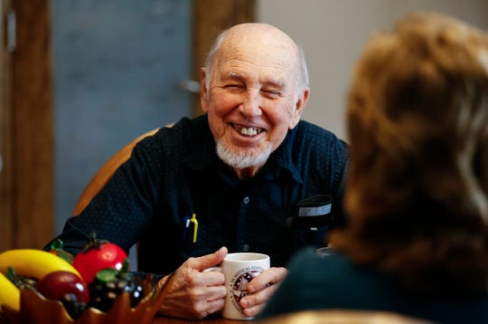 Vietnam veteran Gene Solomon, 77, laughs while talking with Joyce and Frank Keim, whose home he is staying in as part of the VA's Medical Foster Home Program.