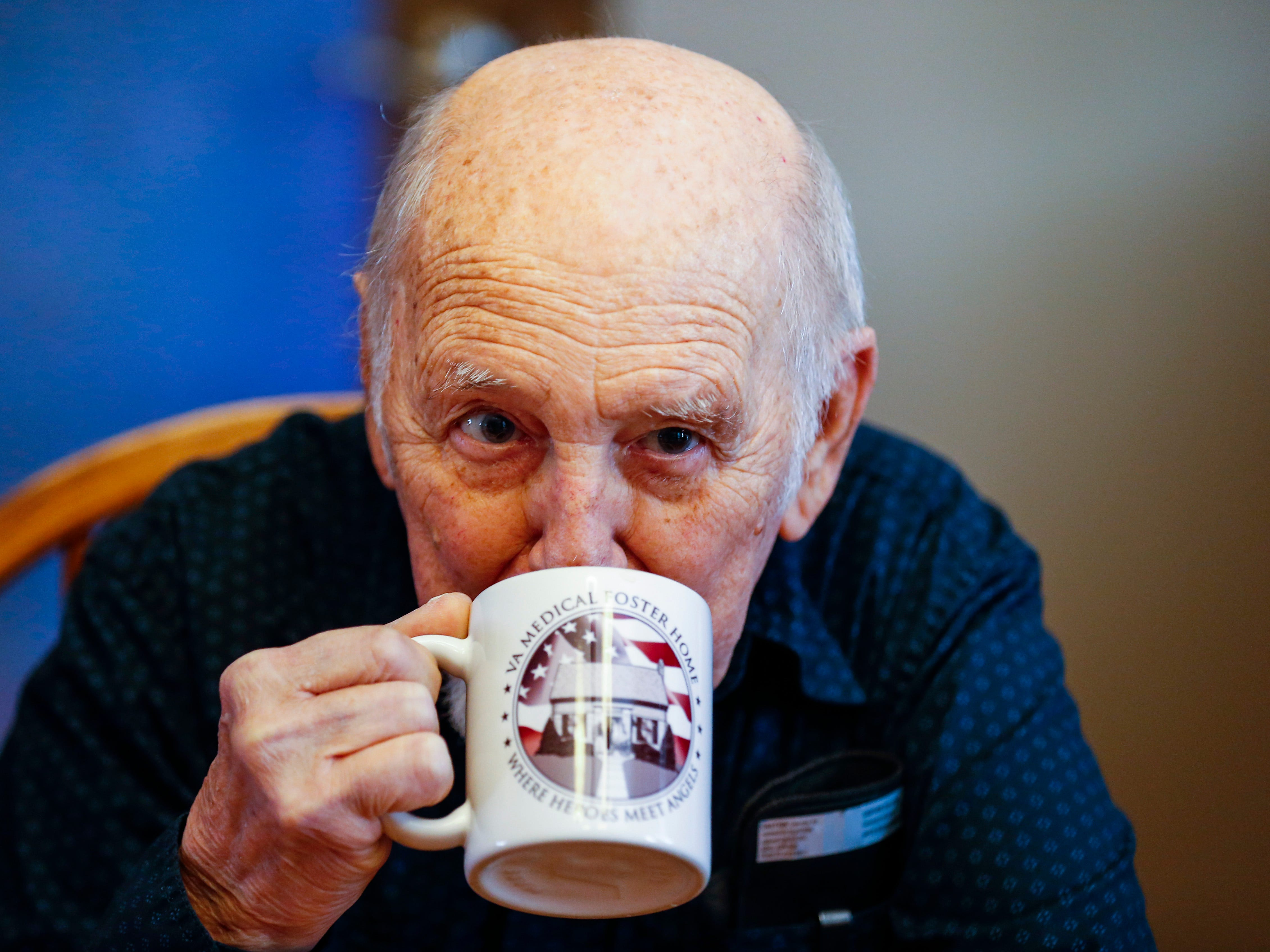 Vietnam veteran Gene Solomon, 77, drink coffee while talking with Joyce and Frank Keim who's home he is staying in as part of the VA's Medical Foster Home Program.
