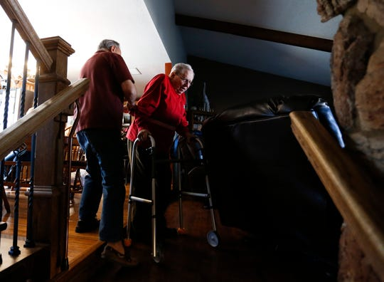 Frank Keim helps veteran Donald Gundlach, 92, down a set of stairs in his home on Tuesday, Jan. 29, 2019. Keim and his wife opened up their home to veterans as part of the VA's Medical Foster Home Program.