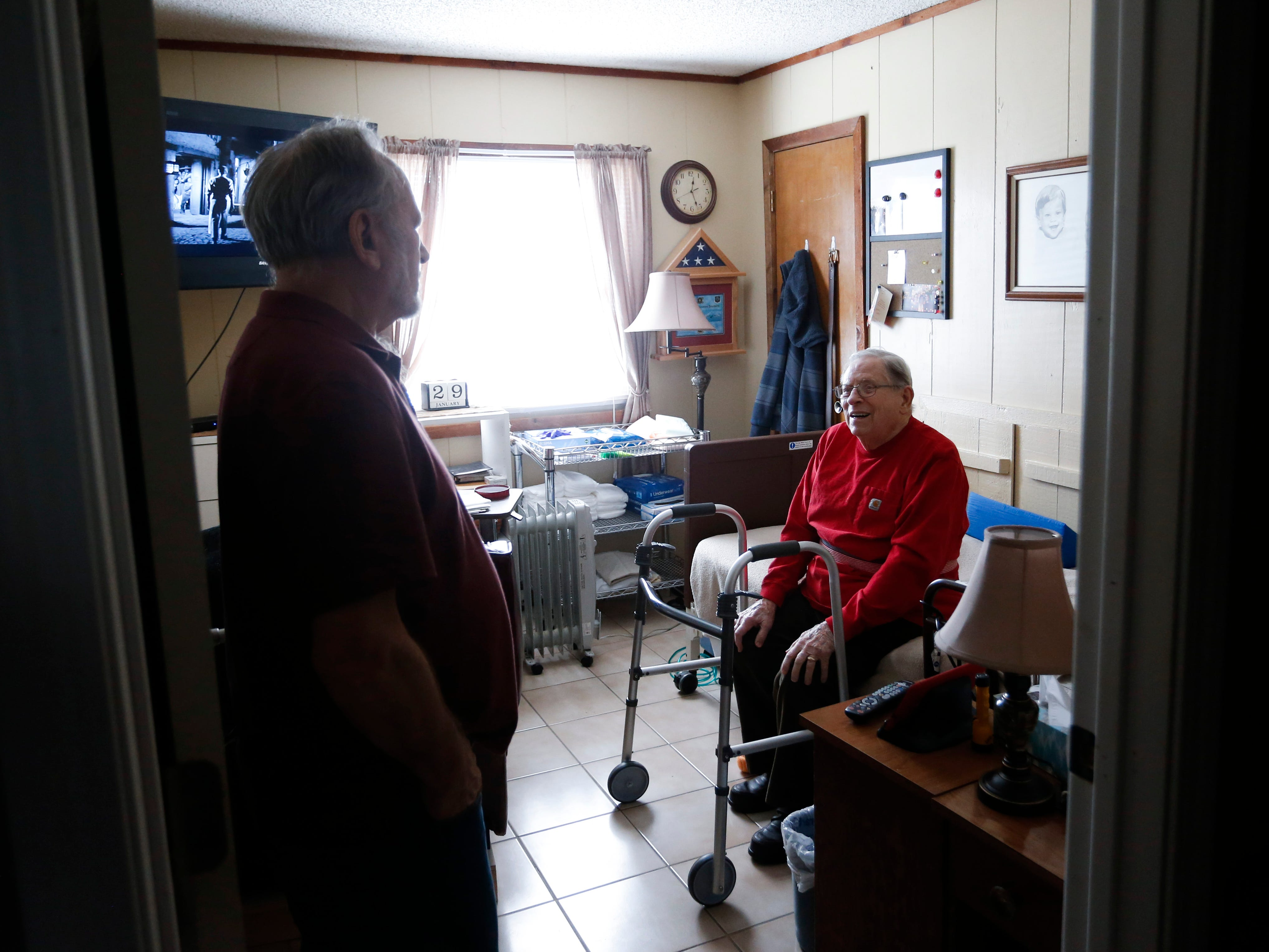 Frank Keim talks with veteran Donald Gundlach, 92, in his room on Tuesday, Jan. 29, 2019. Keim and his wife opened up their home to veterans as part of the VA's Medical Foster Home Program.