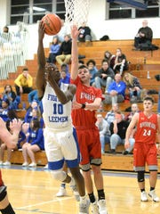 Lee High's Kaleb Hall tries to shoot over Riverheads' Drew Bond Thursday night in a Shenandoah District boys basketball game.
