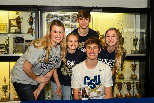 Jacob Jones, seated, signed with Charleston Southern University Thursday afternoon. The Fort Defiance senior will run cross country and track for the Division 1 school. With Jacob are, from left, his mom, Sara; sister, Gracie; brother, Josh; and sister, Madison.