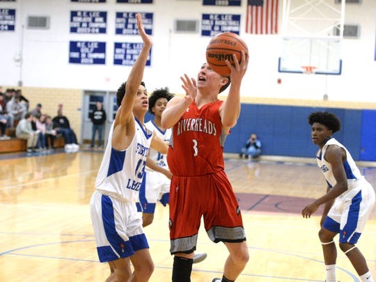 Riverheads' Josh Kinzel looks to get a shot over Lee High's Darrion Simms Thursday night in a Shenandoah District boys basketball game.