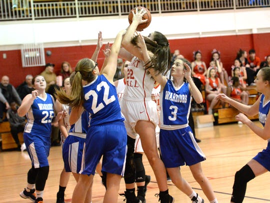 Stuart Hall's Lexie Lee puts up a shot in traffic Thursday in her team's win over Grace Christian.