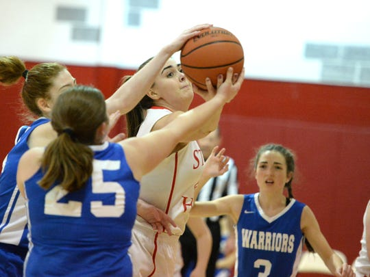 Stuart Hall's Lexie Lee battles for a ball with a pair of Grace Christian players Thursday night.