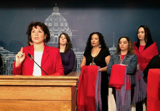 Minnesota State Rep. Mary Kunesh-Podein, D-New Brighton, speaks Jan. 29 at a news conference at the state Capitol.  Kunesh-Podein was flanked by several women holding red shawls that symbolize the plight of missing and murdered indigenous women.