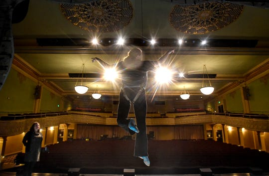 """Kayla Boser rehearses a flying scene as Ariel as director Aimee Miron observes during a rehearsal Thursday, Jan. 31, for the GREAT Theatre production of Disney's """"The Little Mermaid"""" at the Paramount Theatre in St. Cloud."""