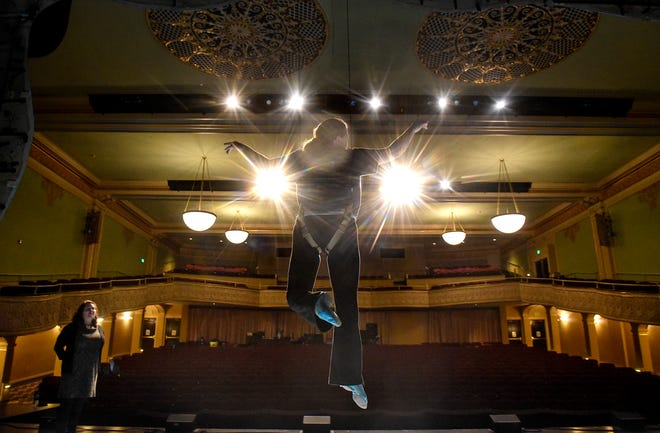 "Kayla Boser rehearses a flying scene as Ariel as director Aimee Miron observes during a rehearsal Thursday, Jan. 31, for the GREAT Theatre production of Disney's ""The Little Mermaid"" at the Paramount Theatre in St. Cloud."