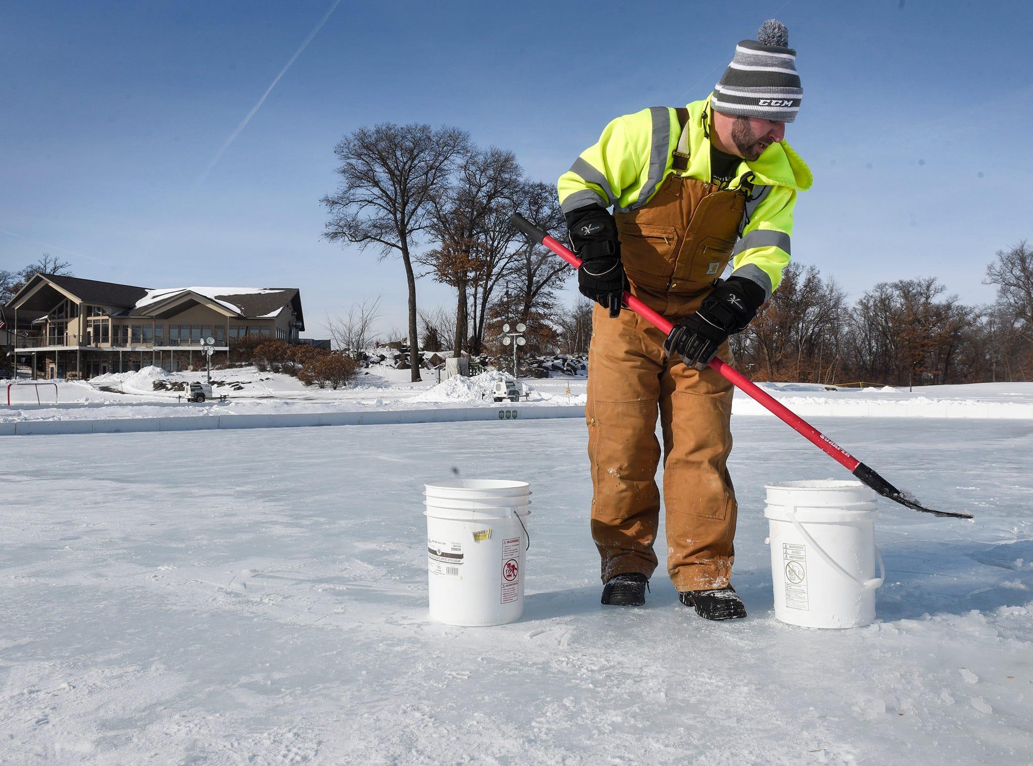 Volunteer Jeremy Koelln prepares one of three hockey rinks for the Granite City Outdoor Hockey Festival Friday, Feb. 1, at Blackberry Ridge Golf Club in Sartell.