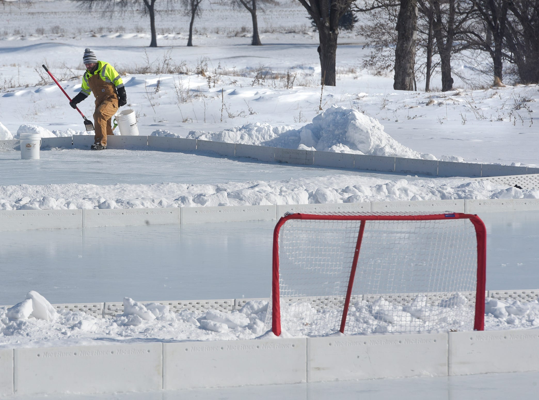 Volunteer Jeremy Koelln works to prepare one of three hockey rinks for the Granite City Outdoor Hockey Festival Friday, Feb. 1, at Blackberry Ridge Golf Club in Sartell. Competition started Friday evening and games were scheduled throughout the day Saturday at Blackberry Ridge. The first event was held in 2012 at Lake George in St. Cloud.